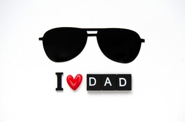 Simpatico poster con lettere in legno per il miglior papà su sfondo bianco Foto Premium
