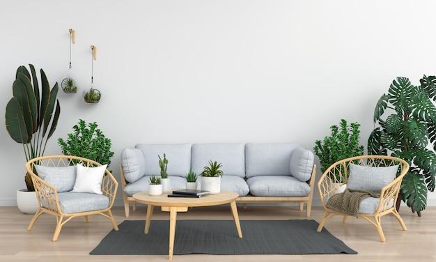 Sofà grigio nella stanza bianca per il modello Foto Premium