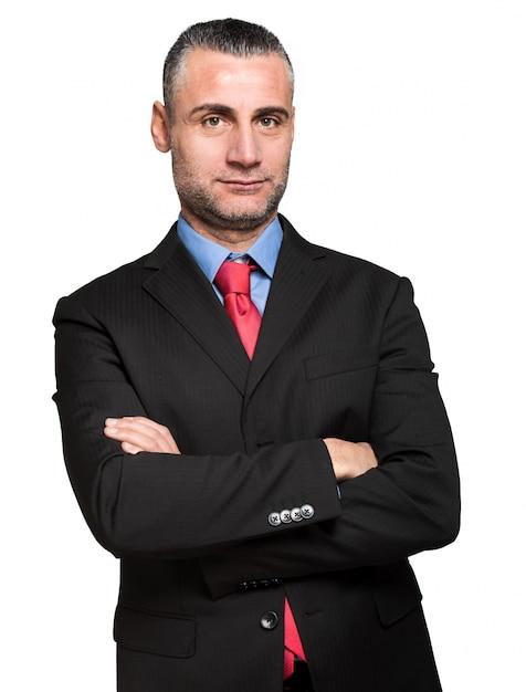 Sorridente uomo d'affari bello. isolato su sfondo bianco Foto Premium