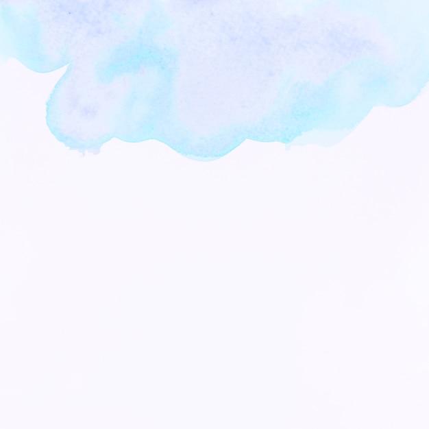 Spruzzata dell'acquerello blu su sfondo bianco Foto Gratuite