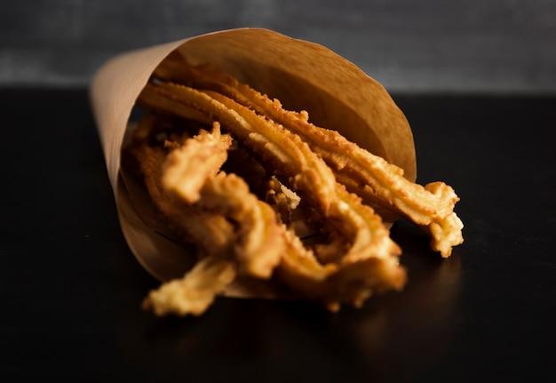Spuntino spagnolo di churros fritti Foto Gratuite