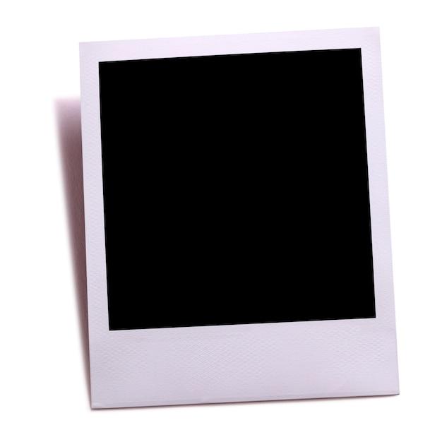 Stampa fotografica in bianco della macchina fotografica istantanea isolata su bianco con ombra. Foto Premium