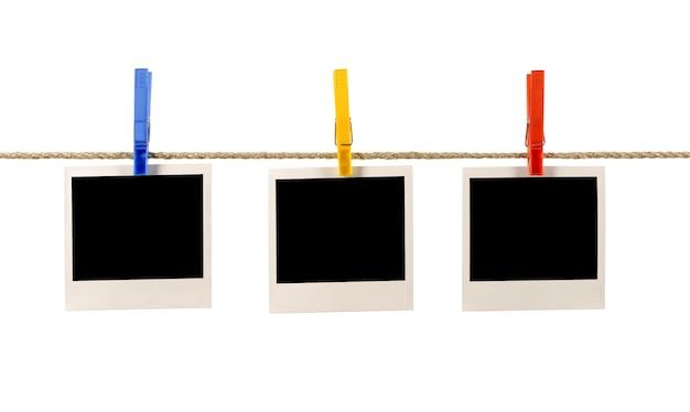 Stampe polaroid appeso su una corda Foto Gratuite