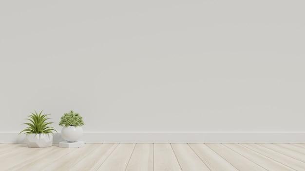 Stanza bianca vuota con piante su un pavimento Foto Premium