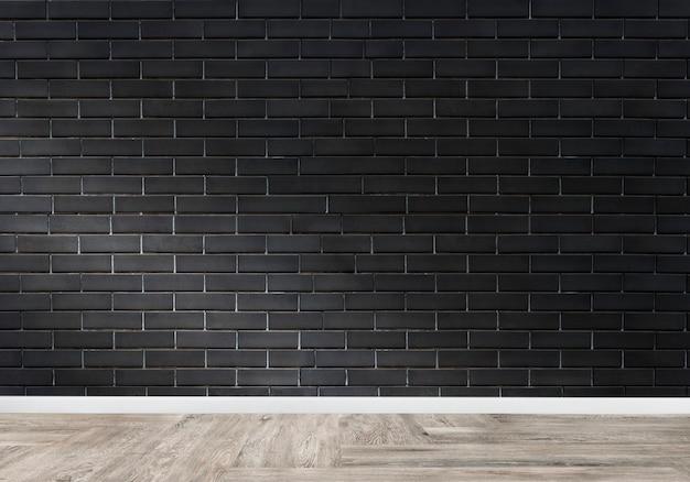 Stanza con un muro di mattoni nero Foto Gratuite