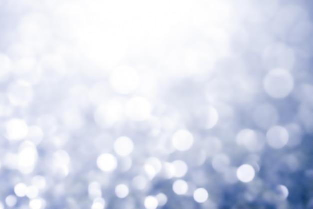 Stelle brillanti della luce dell'estratto di struttura del bokeh di natale su bokeh. luci vintage glitterate Foto Premium