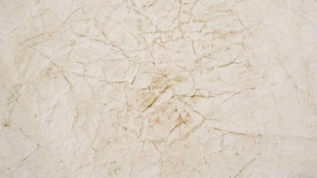 Struttura approssimativa del fondo di lerciume della carta beige Foto Premium