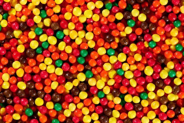 Struttura del fondo del primo piano luminoso variopinto dei dolci. Foto Premium