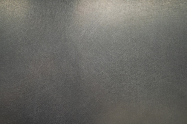 Struttura del metallo graffiato, sfondo di piastra in acciaio spazzolato Foto Premium