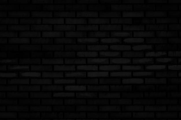 Struttura del muro di mattoni nero di vecchia casa. Foto Premium