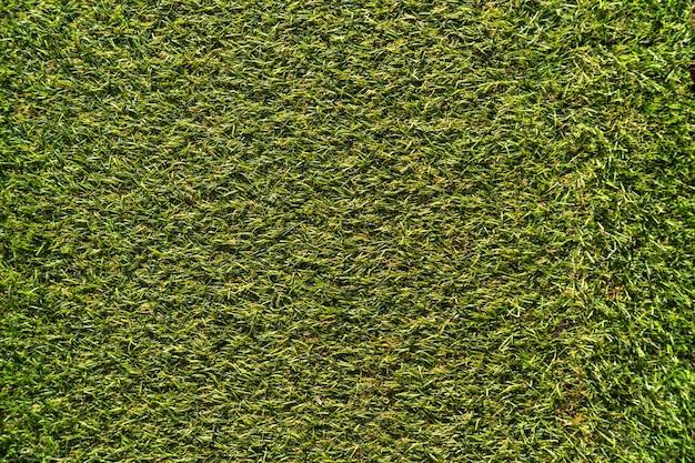 Struttura del tappeto erboso di erba artificiale. sfondo di superficie verde. Foto Premium