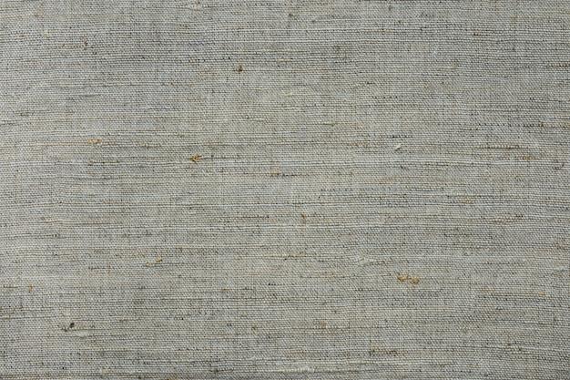 Struttura del tessuto di tela di lino ruvido, sfondo, tessuto, carta da parati, grigio chiaro e beige Foto Premium