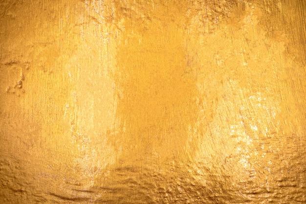 Struttura dell'oro con priorità bassa di pietra Foto Premium