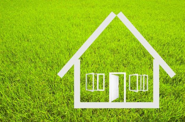 Struttura della casa con fondo in erba Foto Gratuite