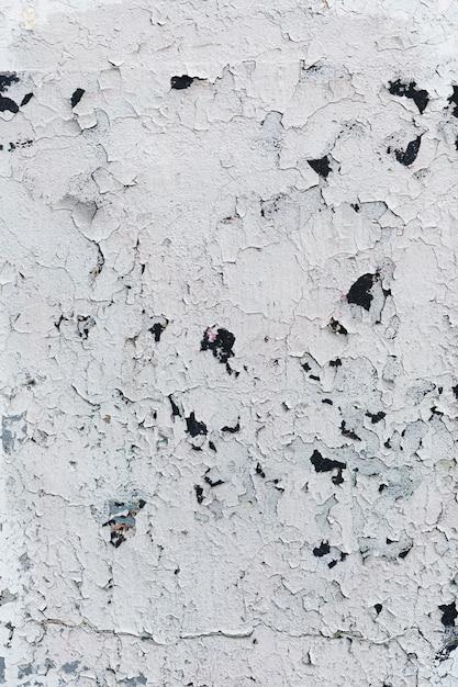 Struttura della parete bianca dipinta incrinata Foto Gratuite
