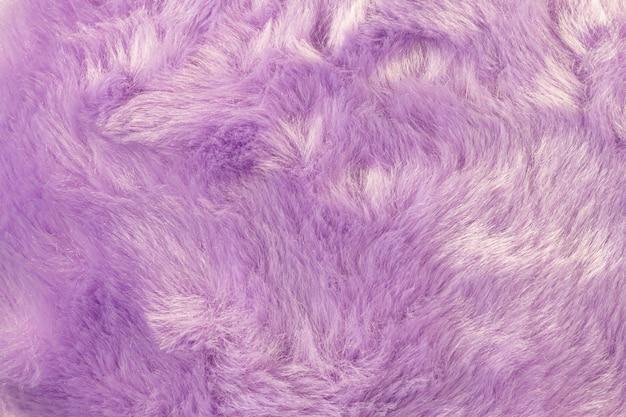 Struttura della priorità bassa della pelliccia shaggy. dettaglio di materiale morbido e peloso. Foto Premium