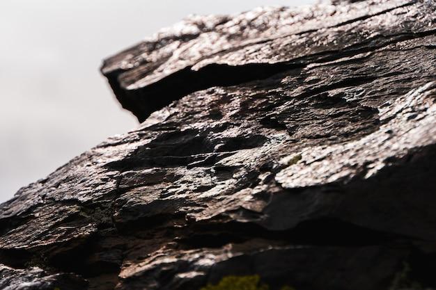 Struttura delle pietre e alto vicino del fondo. trama di roccia Foto Premium