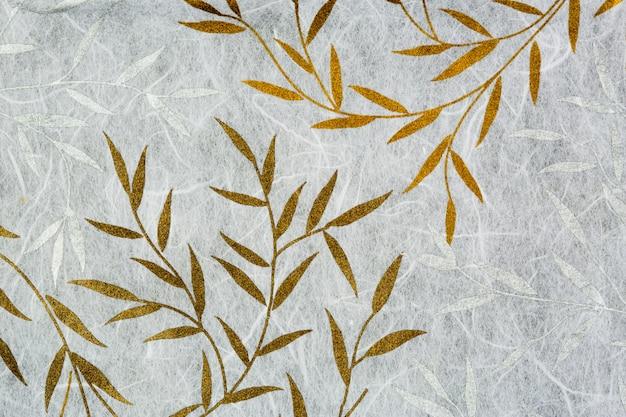 Struttura di carta di gelso con foglia d'oro e d'argento Foto Premium
