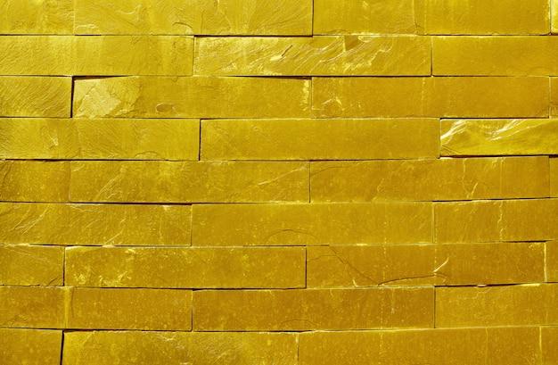 Struttura dorata della parete di pietra dell'ardesia in superficie naturale con l'alta risoluzione per fondo Foto Premium