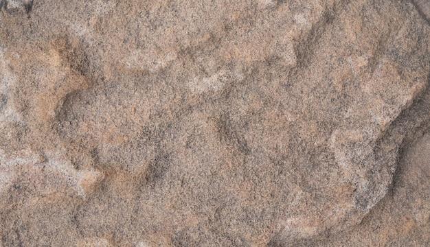 Struttura e fondo astratto del pavimento di pietra marrone Foto Premium