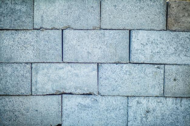 Struttura e fondo della parete del blocco in calcestruzzo senza cuciture Foto Premium