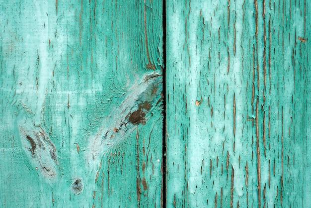 Struttura grossolana di vecchio fondo rustico di legno con la pelatura della pittura verde chiaro. Foto Premium