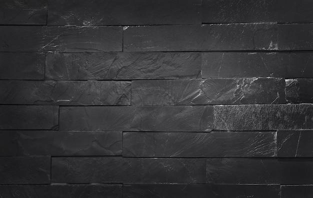 Struttura in ardesia nera grigio scuro ad alta risoluzione, modello di muro di mattoni in pietra e opere d'arte di design. Foto Premium
