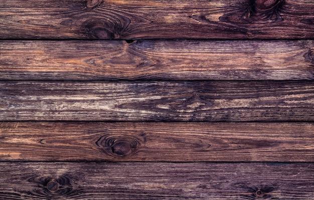 Struttura in legno scuro, vecchio legno graffiato Foto Premium