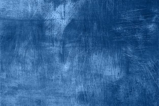 Struttura monocromatica scura astratta di lerciume con i graffi, spazio della copia. colore blu e calmo alla moda. struttura concreta, fondo di pietra Foto Premium