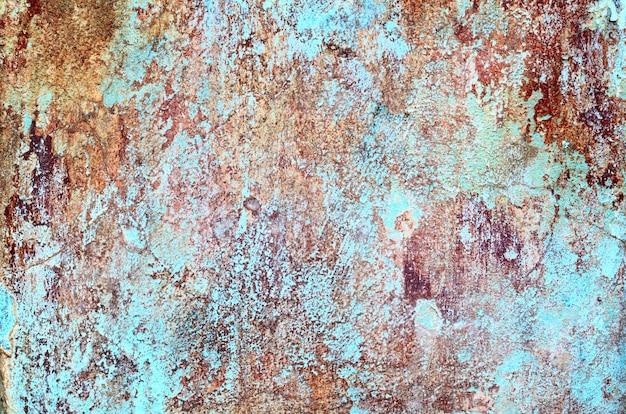 Struttura squallida del grunge di una parete del gesso ricoperta stucco con molti strati di pittura Foto Premium