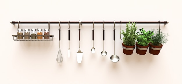Sul muro sono appesi utensili da cucina, rinfuse secche e condimenti vivi in vaso Foto Premium