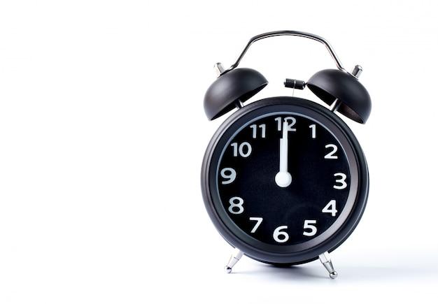 Sveglia nera della doppia campana su fondo bianco Foto Premium