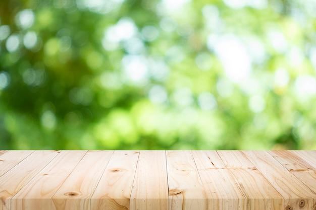 Tabella vuota per prodotto presente con bokeh verde Foto Premium