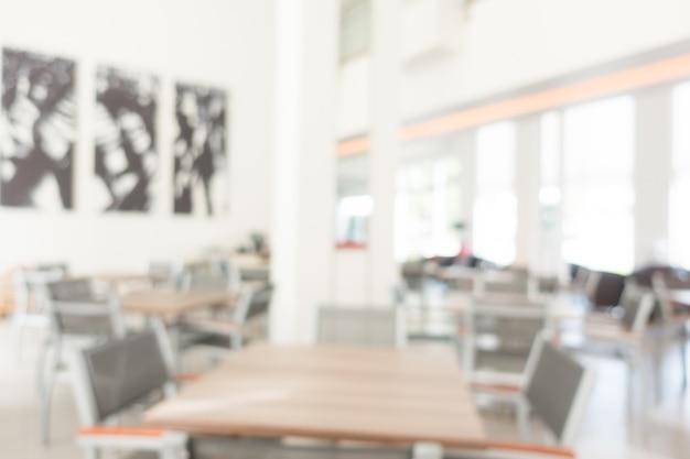 Tavoli con sedie grigie sfocati  Scaricare foto gratis