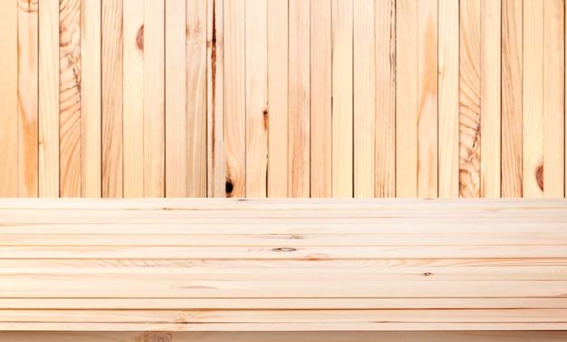 Tavolo in legno chiaro sullo sfondo Foto Gratuite