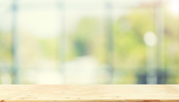Ufficio Legno Bianco : Tavolo in legno di fronte astratto blur sfondo verde bianco dalla