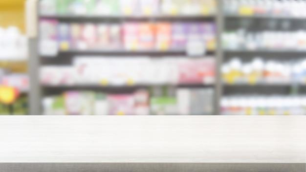 Tavolo in legno in farmacia o farmacia sfondo. Foto Premium