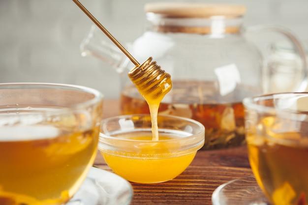 Tazza di tè al limone e miele Foto Premium