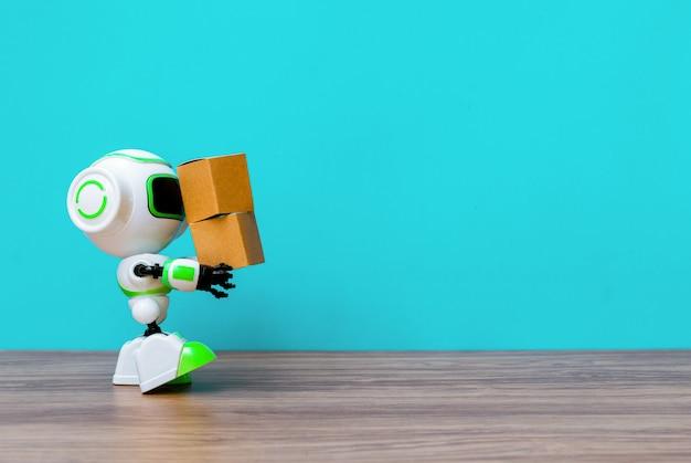 Tecnologia robot che tiene l'industria della scatola o dei robot che lavorano al posto degli umani Foto Premium