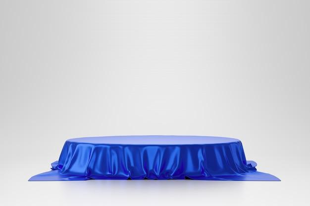 Tessuto o panno lussuoso blu disposto sul piedistallo superiore o sullo scaffale in bianco del podio sulla parete bianca con il concetto di lusso. fondali di musei o gallerie per prodotti. rendering 3d. Foto Premium