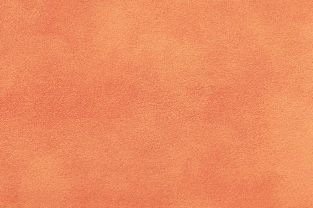 Tessuto scamosciato corallo opaco. velluto texture di sfondo Foto Premium