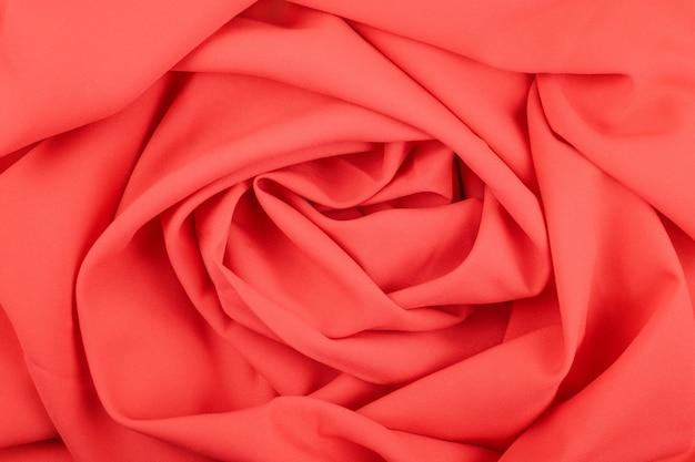 Texture del tessuto opaco rosso corallo con pieghe Foto Premium