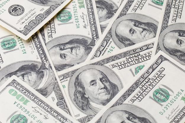 Texture di banconote da un dollaro. cento dollari. Foto Premium