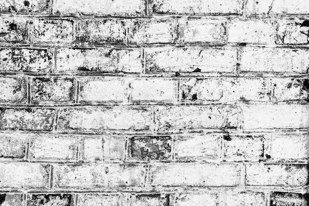 Texture di mattoni con graffi e crepe Foto Premium