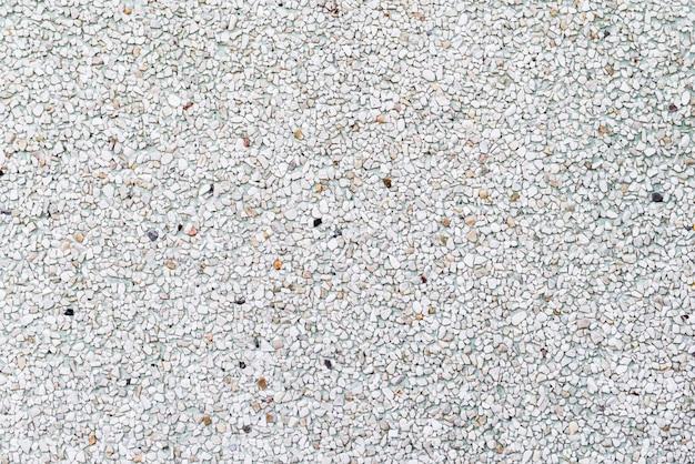 Texture di pali o pavimento che fatta da piccole rocce, pietre Foto Premium