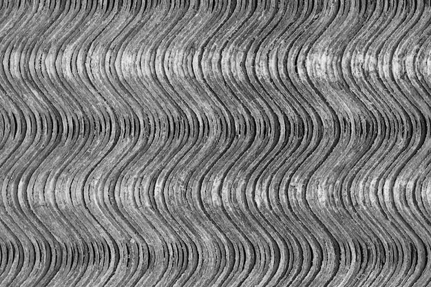Texture di sfondo. i fogli di ardesia si trovano uno sopra l'altro e formano una superficie ondulata verticale. Foto Premium