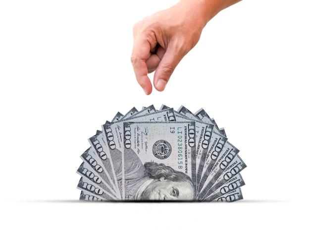 Tiri la mano una metà della banconota del dollaro americano. il dollaro usa è la valuta mondiale e è popolare per lo scambio con altre valute. Foto Premium