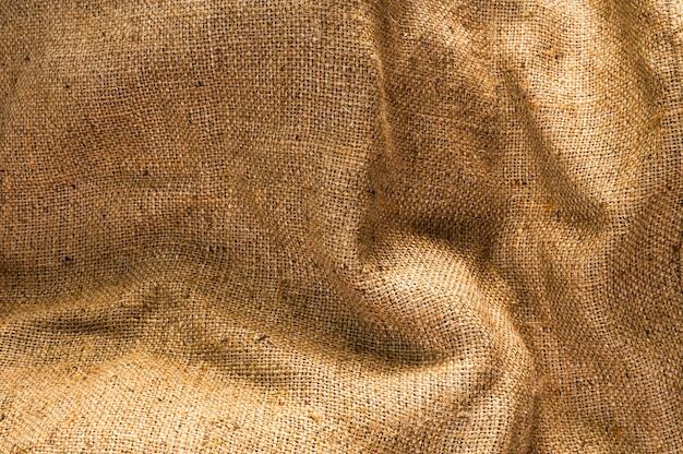 Trama del tessuto beige vintage per lo sfondo Foto Premium