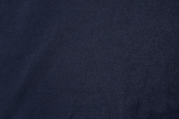 Trama del tessuto di tela blu scuro. fondo in bianco del modello della tessile del cotone. Foto Premium