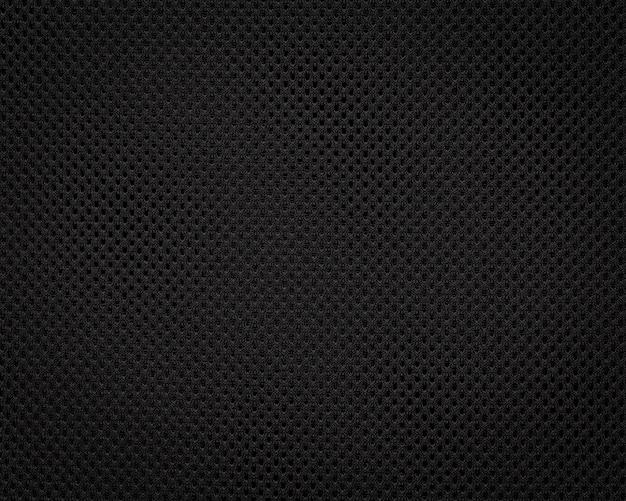Trama del tessuto nero. sfondo scuro modello tessile. dettaglio di materiale sintetico. Foto Premium